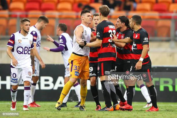 Liam Reddy of the Glory scuffles with Michael Thwaite of the Wanderers after Reddy was sent off during the round 23 ALeague match between the Western...