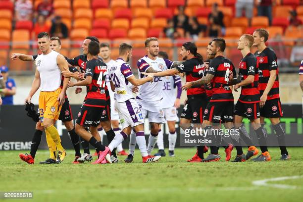 Liam Reddy of the Glory scuffles with the Wanderers players after Reddy was sent off during the round 23 ALeague match between the Western Sydney...