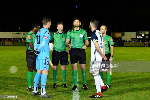 Liam Reddy of the Gloryp and Carl Valeri of the Victory attend the coin toss during the FFA Cup round of 32 match between Perth Glory and Melbourne...