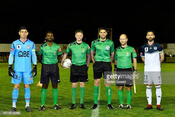 Liam Reddy of the Gloryp and Carl Valeri of the Victory pose with match officials during the FFA Cup round of 32 match between Perth Glory and...