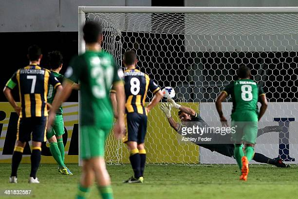 Liam Reddy of the Mariners saves a penalty during the Asian Champions League match between the Central Coast Mariners and Beijing Guoan at Bluetongue...