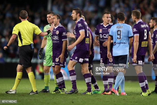 Liam Reddy Richard Garcia and Dino Djulbic of the Glory make their point to referee Peter Green during the ALeague Semi Final match between Sydney FC...