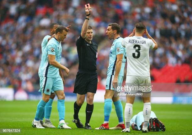 Liam Ridehalgh of Tranmere Rovers reacts as he is shown a red card by referee Neil Hair and is sent off after a foul on Ricky Shakes of Boreham Wood...