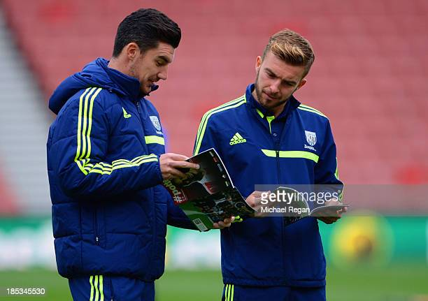 Liam Ridgewell and James Morrison of West Brom read the matchday programme before the Barclays Premier League match between Stoke City and West...