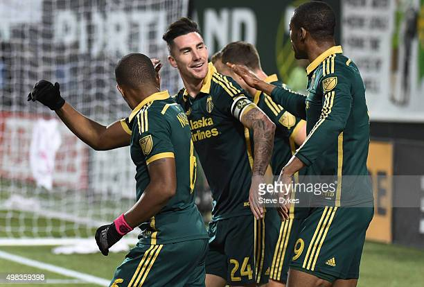Liam Ridgewell of Portland Timbers celebrates with teammates after scoring a goal during the first half of the match against the FC Dallas at...
