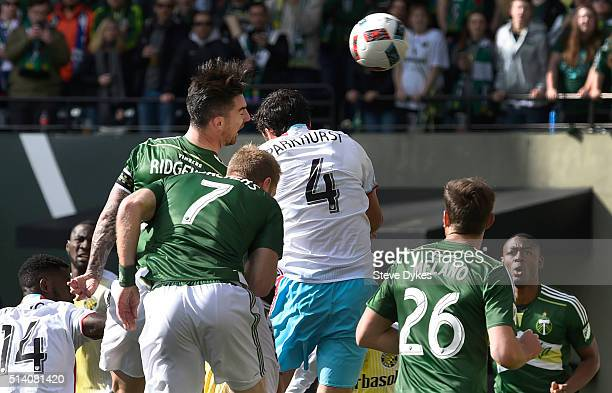 Liam Ridgewell of Portland Timbers heads a ball on goal as Michael Parkhurst of Columbus Crew defends during the first half of the game at Providence...