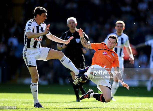 Liam Ridgewell of West Brom and Danny Guthrie of Newcastle compete for the ball during the Barclays Premier League match between West Bromwich Albion...