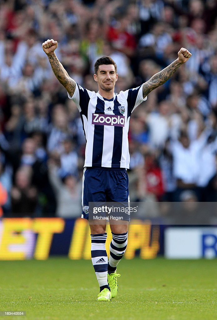 Liam Ridgewell of West Bromwich Albion celebrates as Claudio Yacob of West Bromwich Albion (not pictured) scores their first goal during the Barclays Premier League match between West Bromwich Albion and Arsenal at The Hawthorns on October 6, 2013 in West Bromwich, England.