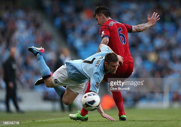 Liam Ridgewell of West Bromwich Albion challenges James Milner of Manchester City during the Barclays Premier League match between Manchester City...