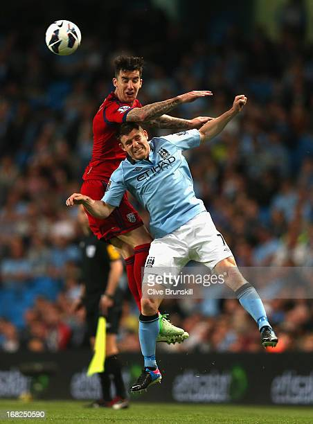 Liam Ridgewell of West Bromwich Albion competes with James Milner of Manchester City during the Barclays Premier League match between Manchester City...