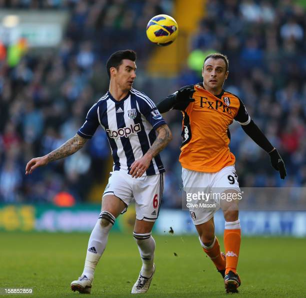 Liam Ridgewell of West Bromwich Albion is tackled by Dimitar Berbatov of Fulham during the Barclays Premier League match between West Bromwich Albion...