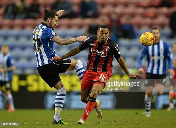 Liam Ridgewell of Wigan Athletic challenges Callum Wilson of AFC Bournemouth during the Sky Bet Championship match between Wigan Athletic and AFC...