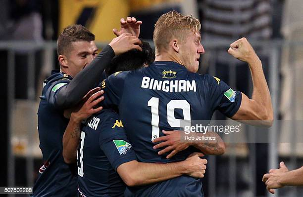 Liam Rose congratulates Luis Garcia of the Central Coast Mariners on his goal during the round 17 ALeague match between the Wellington Phoenix and...