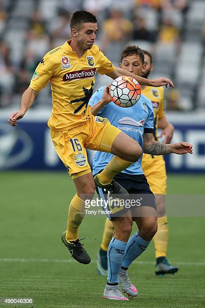 Liam Rose of the Mariners contests the ball with Filip Holosko of Sydney FC during the round four A-League match between the Central Coast Mariners...