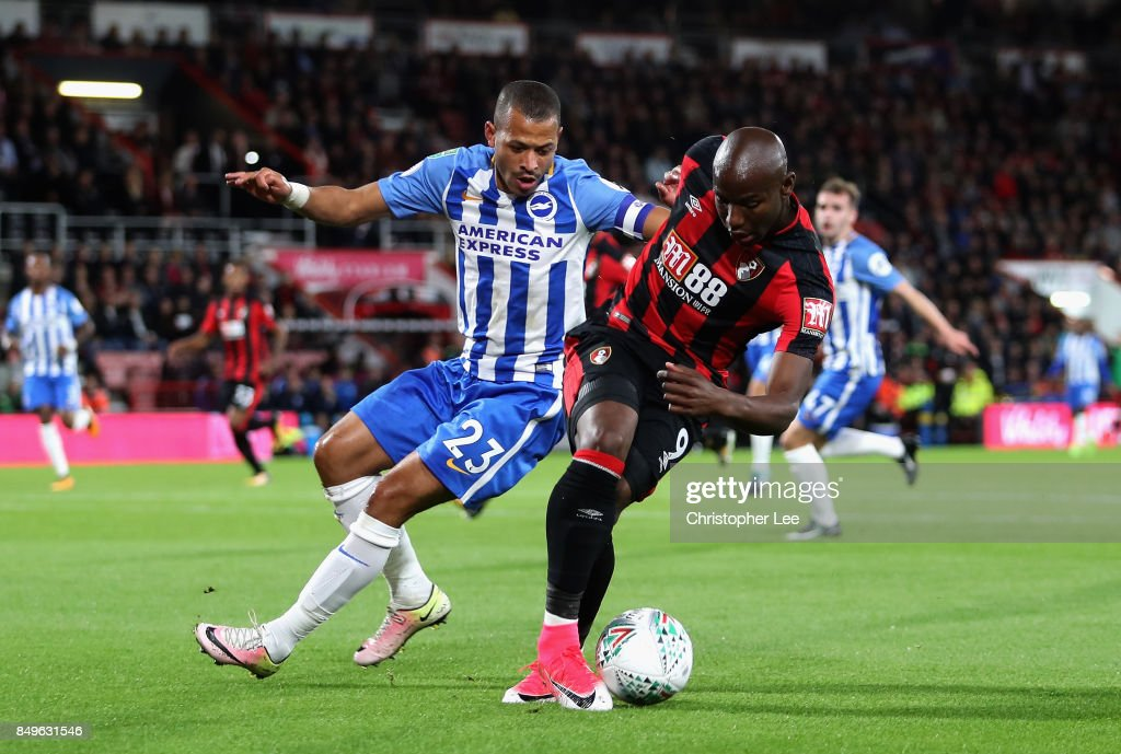 Liam Rosenior of Brighton and Hove Albio and Benik Afobe of AFC Bournemouth battle for possession during the Carabao Cup Third Round match between AFC Bournemouth and Brighton and Hove Albion at Vitality Stadium on September 19, 2017 in Bournemouth, England.