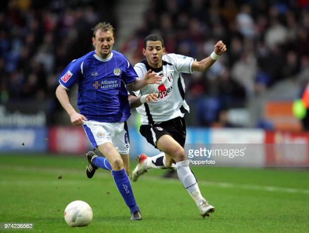 Liam Rosenior of Fulham and Stephen Hughes of Leicester City in action during the FA Cup 3rd Round match between Leicester City and Fulham at the...