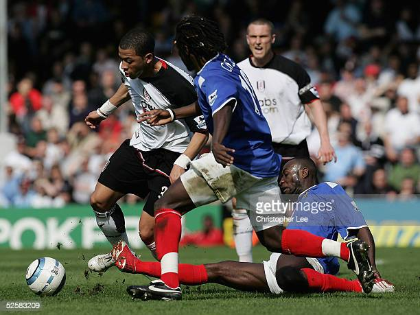 Liam Rosenior of Fulham is tackled by Aliou Cisse and Lomana Lualua of Portsmouth during the Barclays Premiership match between Fulham and Portsmouth...