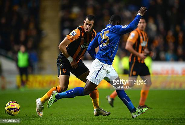 Liam Rosenior of Hull City and Jeffrey Schlupp of Leicester City compete for the ball during the Barclays Premier League match between Hull City and...