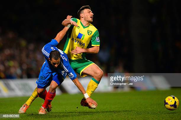Liam Rosenior of Hull City and Robert Snodgrass of Norwich City tussle for the ball during the Barclays Premier League match between Norwich City and...