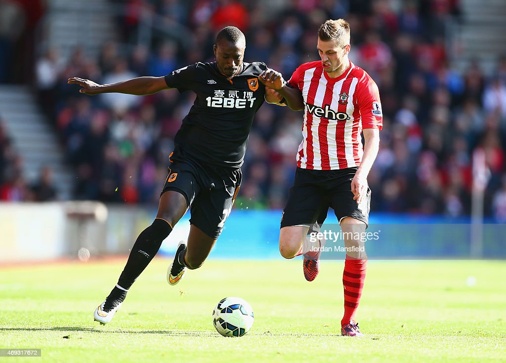 Liam Rosenior of Hull City holds off Morgan Schneiderlin of Southampton during the Barclays Premier League match between Southampton and Hull City at St Mary's Stadium on April 11, 2015 in Southampton, England.