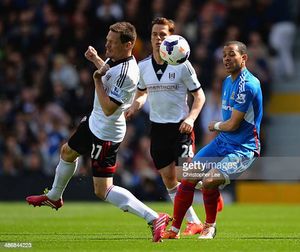 Liam Rosenior of Hull City is closed down by Sascha Riether of Fulham during the Barclays Premier League match between Fulham and Hull City at Craven...