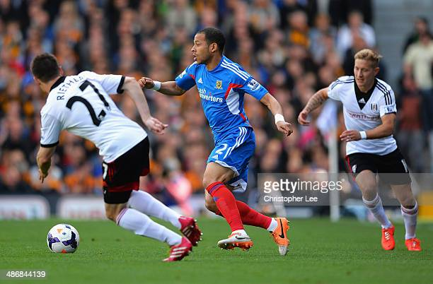 Liam Rosenior of Hull City takes on the Fulham defence during the Barclays Premier League match between Fulham and Hull City at Craven Cottage on...