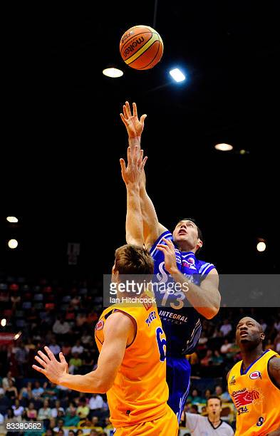 Liam Rush of the Spirit contests the ball with Cameron Tovey of the Crocodiles during the round six NBL match between the Townsville Crocodiles and...