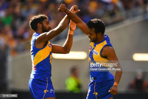 Liam Ryan and Willie Rioli of the Eagles celebrates a goal during the 2018 AFL round 22 match between the West Coast Eagles and the Melbourne Demons...