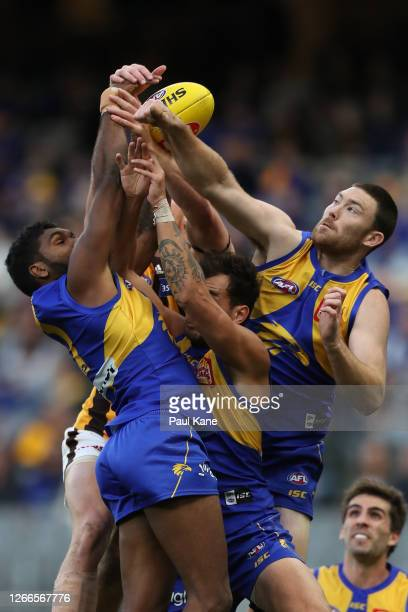 Liam Ryan, Brendon Ah Chee and Jeremy McGovern of the Eagles contest for a mark against Tim O'Brien of the Hawks during the round 12 AFL match...
