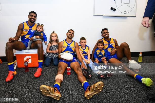 Liam Ryan Lewis Jetta and Willie Rioli of the Eagles with this kids in the rooms during the 2018 AFL Second Preliminary Final match between the West...