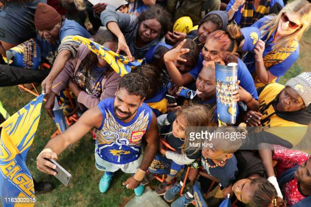 Liam Ryan of the Eagles interacts with fans after the round 18 AFL match between the Melbourne Demons and the West Coast Eagles at TIO Traeger Park...