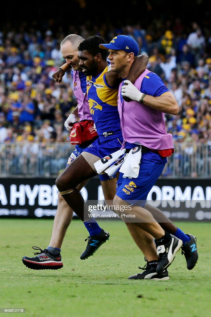 Liam Ryan of the Eagles is assisted off the field during the round three AFL match between the West Coast Eagles and the Geelong Cats at Optus Stadium on April 8, 2018 in Perth, Australia.
