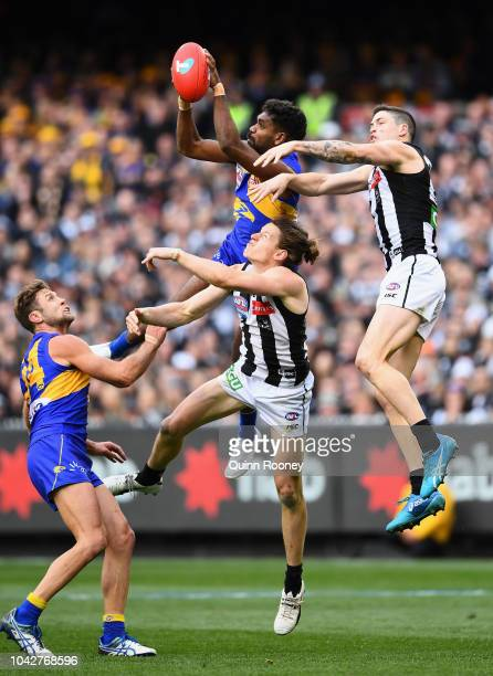 Liam Ryan of the Eagles marks over Tom Langdon of the Magpies during the 2018 AFL Grand Final match between the Collingwood Magpies and the West...