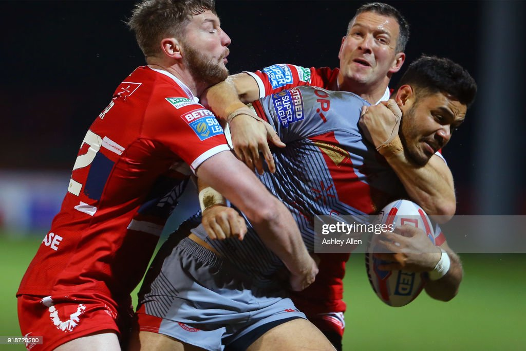 Liam Salter (L) and Danny McGuire (R) of Hull KR tackle Fouad Yaha (C) of the Catalans Dragons during the BetFred Super League match between Hull KR and Catalans Dragons at KCOM Craven Park on February 15, 2018 in Hull, England.