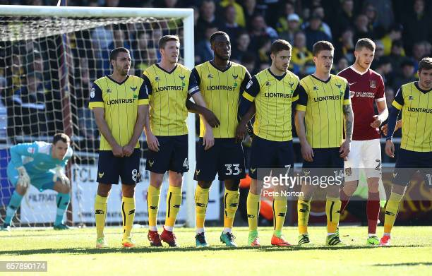 Liam Sercombe, John Lundstram, Chey Dunkley, Antonio Martinez and Josh Ruffles of Oxford United line up to defend a free kick during the Sky Bet...
