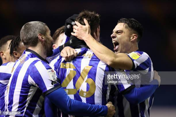 Liam Shaw of Sheffield Wednesday celebrates with teammates Callum Paterson and Joey Pelupessy after scoring his team's second goal during the Sky Bet...