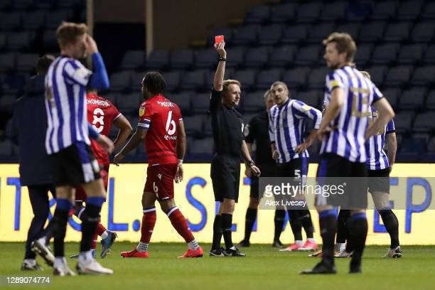 Liam Shaw of Sheffield Wednesday receives a red card from Match Referee, Oliver Langford during the Sky Bet Championship match between Sheffield...