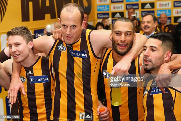 Liam Shiels David Hale Josh Gibson and Paul Puopolo of the Hawks sing the song in the rooms after winning the AFL 2nd Qualifying Final match between...