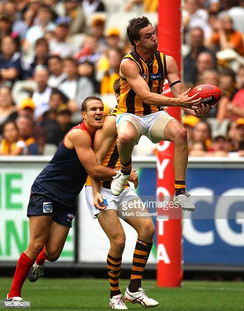 Liam Shiels of the Hawks flies for a mark during the round one AFL match between the Melbourne Demons and the Hawthorn Hawks at Melbourne Cricket...