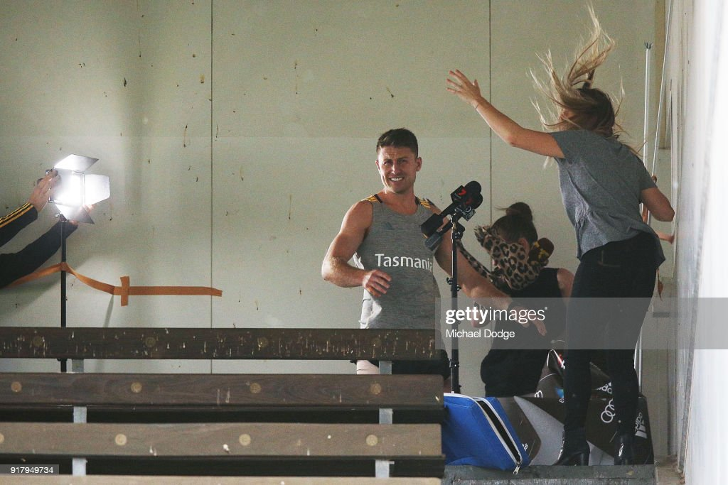 Liam Shiels of the Hawks helps evacuate the media conference location as a storm whips through during a Hawthorn Hawks AFL training session on February 14, 2018 in Melbourne, Australia.