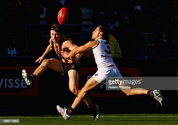 Liam Shiels of the Hawks kicks under pressure during the round eight AFL match between the Hawthorn Hawks and the Greater Western Sydney Giants at...