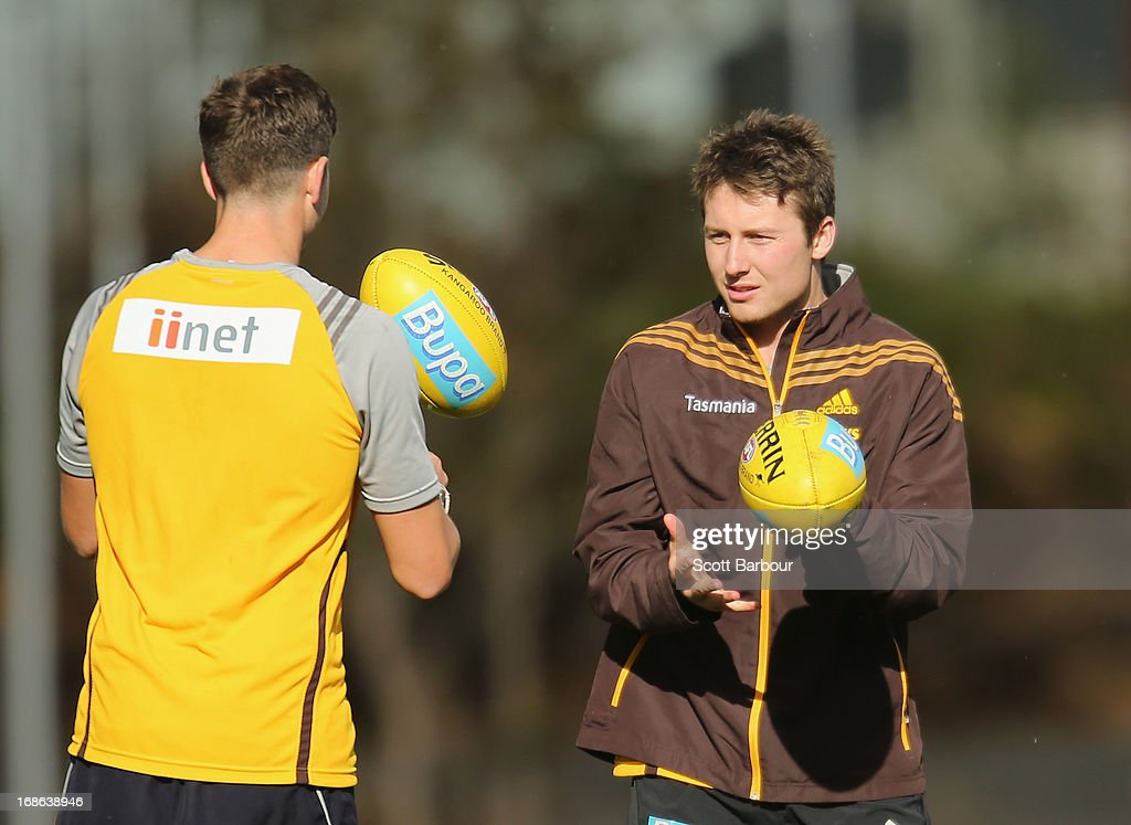 Liam Shiels of the Hawks passes the ball during a Hawthorn Hawks AFL training session at Waverley Park on May 13, 2013 in Melbourne, Australia.