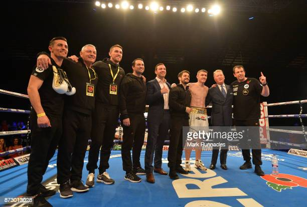 Liam Smith celebrates with his coaching and management team after beatingLiam Williams during an Official Eliminator for the WBO World...