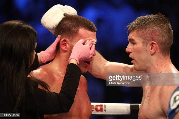 Liam Smith consoles Liam Williams after his 10th round victory during their WBO Interim World SuperWelterweight fight at Manchester Arena on April 8...