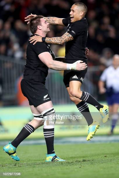 Liam Squire of the All Blacks is congratulated on his try by Aaron Smith during The Rugby Championship game between the New Zealand All Blacks and...