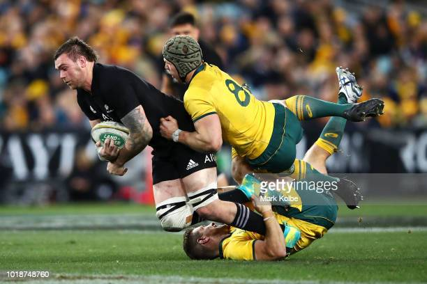 Liam Squire of the All Blacks is tackled by David Pocock and Bernard Foley of the Wallabies during The Rugby Championship Bledisloe Cup match between...
