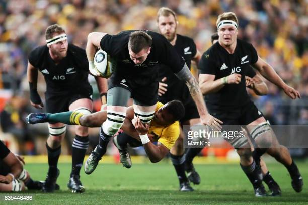 Liam Squire of the All Blacks is tackled by Will Genia of the Wallabies during The Rugby Championship Bledisloe Cup match between the Australian...