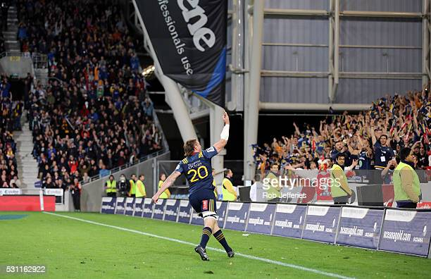 Liam Squire of the Highlanders celebrates his try during the round twelve Super Rugby match between the Highlanders and Crusaders at Forsyth Barr...