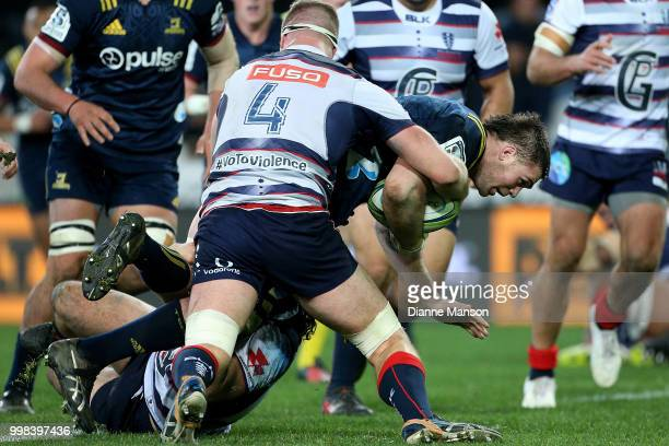 Liam Squire of the Highlanders charges forward during the round 19 Super Rugby match between the Highlanders and the Rebels at Forsyth Barr Stadium...