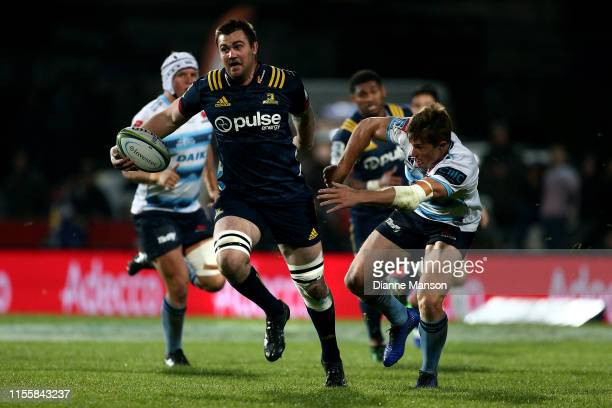 Liam Squire of the Highlanders makes a break during the round 18 Super Rugby match between the Highlanders and the Waratahs at Rugby Park Stadium on...
